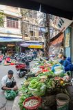 Busy local daily life of the morning street market in Hanoi, Vietnam. A busy crowd of sellers and buyers in the market. Hanoi,Vietnam - October 31,2017 : Busy Royalty Free Stock Images