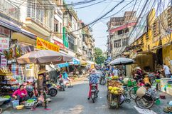 Busy local daily life of the morning street market in Hanoi, Vietnam. A busy crowd of sellers and buyers in the market. Hanoi,Vietnam - October 31,2017 : Busy Royalty Free Stock Photos