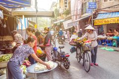 Busy local daily life of the morning street market in Hanoi, Vietnam. People can seen exploring around the market. Hanoi,Vietnam - November 2,2017 : Busy local Stock Photos