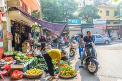 Busy local daily life of the morning street market in Hanoi, Vietnam. People can seen exploring around it. Stock Photo
