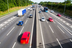 Busy M1 Motorway. Looking down from above onto a busy motorway or highway with traffic speeding by, causing motion blur royalty free stock image