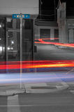 Busy main street with traffic light trails Stock Images