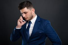 Busy male ceo talking on the phone. Busy male ceo talking business on the phone or calling somoebody important Royalty Free Stock Photos