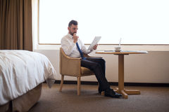 Busy male lawyer working in his hotel room stock images