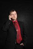 Busy man. Busy business man calling by phone Royalty Free Stock Image