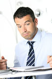 Busy man. Hiding behind a stack of files Royalty Free Stock Image