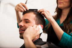 Busy man in a barber shop Stock Image