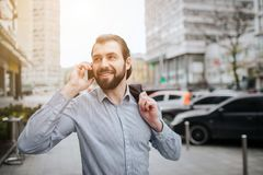 Busy man is in a hurry, he does not have time, he is going to talk on the phone on the go. Businessman doing multiple royalty free stock image