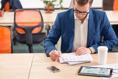 Busy man sitting at the table Stock Photography