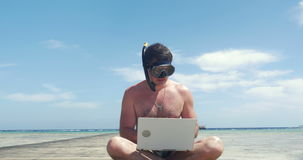 Busy Man in Snorkel and Mask with Laptop