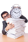 Busy man with stack of papers i Stock Images