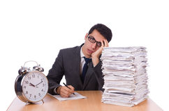 Busy man with stack of papers isolated Royalty Free Stock Image