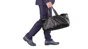 Busy man walking with leather bag on white background. stock footage