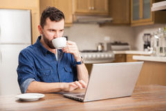 Busy man working at home Stock Photography