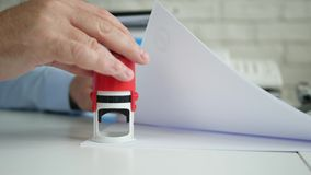 Busy Manager Stamping Some Papers and Documents Using a Rubber Stamp stock video footage
