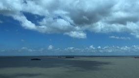 A busy maritime transportation industry. Busy transport ships in the east China sea. Blue sky. Time-lapse photography. The flow of cloud. Wide scene. Changes in stock video