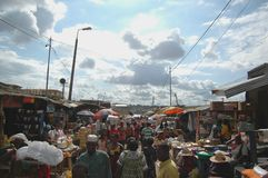 Busy market in Kumasi, Ghana. Kumasi, Ghana: 21st July 2016 - a bustling lane in a market in the city of Kumasi, Ghana stock photo