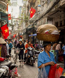 Busy market street in the Old Quarter of Hanoi, Vietnam Stock Photos