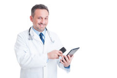 Busy medic or doctor using tablet and phone Royalty Free Stock Photo