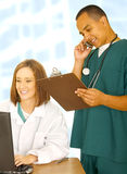 Busy Medical Staff Doing Various Things Royalty Free Stock Photography