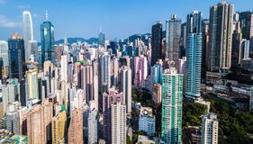 Busy metropolis with high buildings. Drone view of busy metropolis with high crowded buildings in Hong Kong Stock Photo