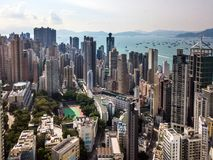 Busy metropolis by the ocean. Drone view of metropolis with high buildings by the ocean Stock Photo