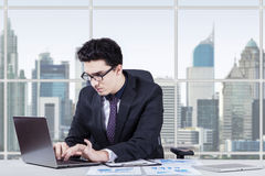 Busy middle eastern entrepreneur working in office Stock Image