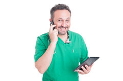 Busy and modern doctor multitasking Stock Photo