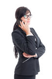 Busy and modern saleswoman talking on smartphone Royalty Free Stock Images