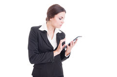 Busy modern young business woman holding and using tablet Stock Photography