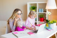 Busy mom multitasking. Working mom with kids stock images