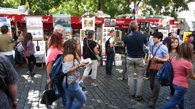 Busy Montmartre Market Place in Paris. Video of busy artwork market place in montmartre in paris france on 9/15/14. Montmartre is a place where artwork is sold stock video footage
