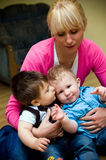 Busy mother. Mother busy with two baby boys Stock Image
