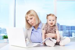 Busy mother Stock Image