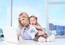 Busy mother Royalty Free Stock Photos