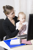 Busy mother with her baby Stock Images