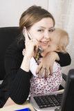 Busy mother with her baby stock photo