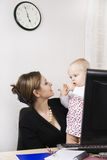 Busy mother with her baby stock photos