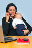 Busy mother with her baby Royalty Free Stock Photo