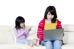 Busy mother and her daughter Royalty Free Stock Photos