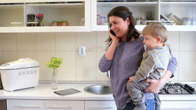 Busy Mother in Kitchen stock video footage