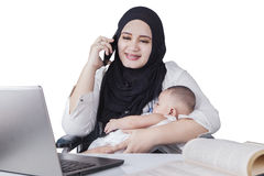 Busy Mother Nursing her Baby Royalty Free Stock Photo