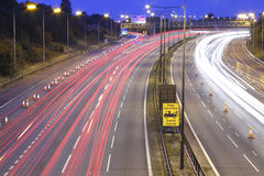 Busy motorway roadworks. Busy M6 motorway road at night with lane closed for roadworks stock image