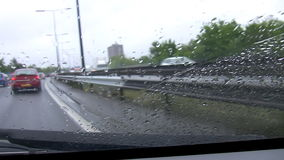 Busy motorway on a rainy day stock footage