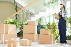 Busy moving expert calling to report about delivery stock photography