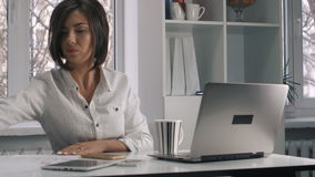 Busy multitasking attractive business woman in the office. Busy multitasking attractive businesswoman in the office stock footage