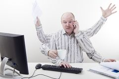Overworked and Busy Businessman Royalty Free Stock Image