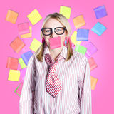 Female admin clerk swamped with multitasking jobs. Busy nerdy business woman inundated with tasks in a hectic work schedule concept Royalty Free Stock Images