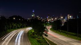 A time lapse of rapidly moving traffic on an s curve in Chicago, USA. A busy night in the city. A time lapse of rapidly moving traffic on an s curve in Chicago stock video footage