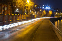 Busy night road. Urban city road with car light trails at night Royalty Free Stock Image